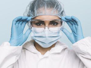 Female Doctor or Nurse Wearing latex protective gloves and medical Protective Mask and glasses on face. Protection for Coronavirus COVID-19 : Stockfoto oder Stockvideo und Fotos, Bilder, Stockmedien von rcfotostock | RC-Photo-Stock