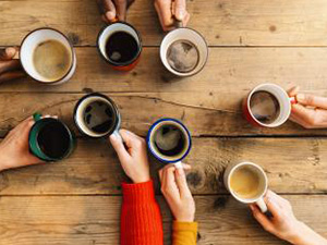Friends group drinking coffee and cappuccino in a bar or restaurant - People hands cheering and toasting on top view point - breakfast together concept with white and black men and women : Stockfoto oder Stockvideo und Fotos, Bilder, Stockmedien von rcfotostock | RC-Photo-Stock