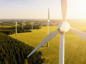 Wind turbines and agricultural fields on a summer day - Energy Production with clean and Renewable Energy - aerial shot, analog image style : Stockfoto oder Stockvideo und Fotos, Bilder, Stockmedien von rcfotostock | RC-Photo-Stock