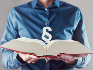young man holding book with paragraph sign - law concept image : Stockfoto oder Stockvideo und Fotos, Bilder, Stockmedien von rcfotostock | RC-Photo-Stock